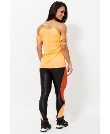 pantalone aderente bicolore, nero e arancione, moda sportiva, fitness wear,