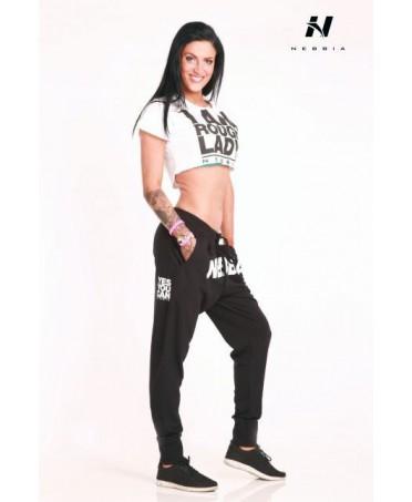 pantalone modello largo tinta unita nero con scritta bianca, fitness wear on line, moda palestra,
