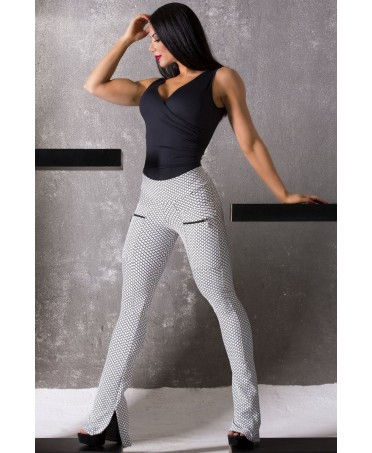 pantacalze aderenti moda sportiva, pantaloni aderenti per sport, pantalone zampa di elefante canoan bianco,