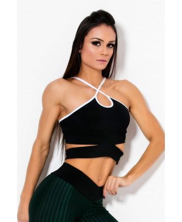 top sportivo nero con profili bianchi con coppe al seno removibili, particolare scollatura ad intreccio