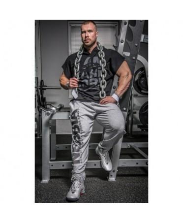tuta nebbia grigio chiaro taglio largo e morbido con elastico in vita e logo sulla coscia, moda uomo sportiva,