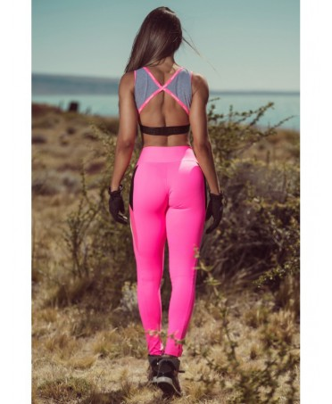 Leggings fuchsia Superhot with black inserts and inserts in micromesh fuchsia. Momentum of the figure due to compression on the